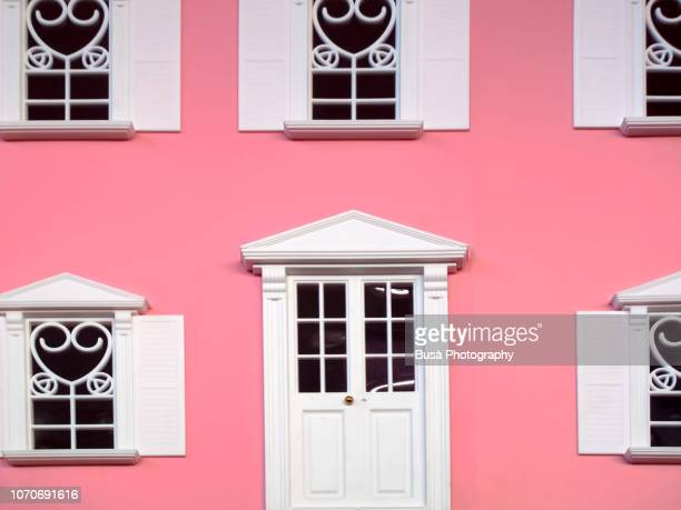 facade of pink miniature dollhouse - barbie stock photos and pictures