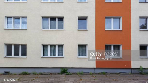 facade of prefabricated housing (plattenbau) in east berlin, germany - facade stock pictures, royalty-free photos & images