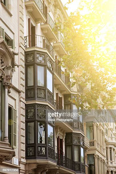 Facade of residential buildings in Passeig de Gracia, a major upscale commercial avenue in Barcelona, Spain