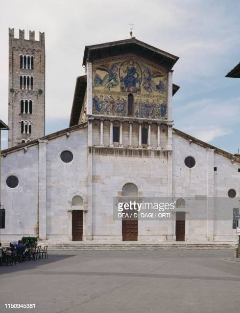 Facade of San Frediano Basilica with false loggia and mosaic depicting the Ascension of Christ among angels and apostles with the bell tower in the...