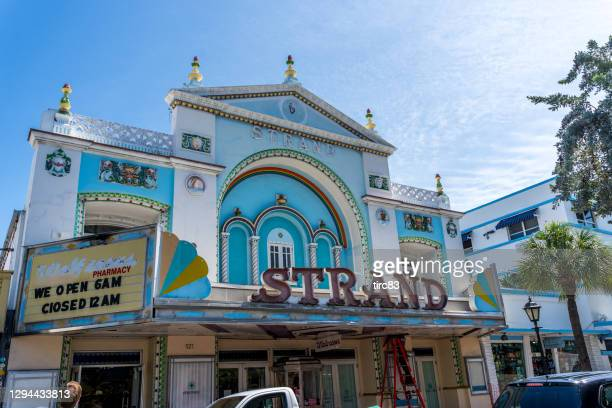 facade of strand movie theatre in key west - duval street stock pictures, royalty-free photos & images