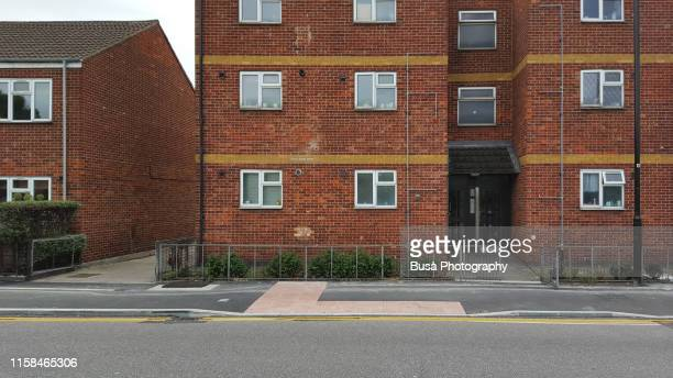 facade of suburban council housing in the district of stratford in london, uk - facade stock pictures, royalty-free photos & images
