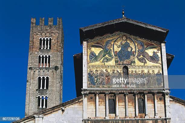 Facade of the Basilica of San Frediano with the false loggia and the mosaic depicting the Ascension of Christ among angels and apostles with the bell...