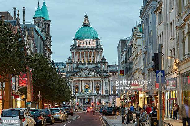 facade of the belfast city hall at dusk - belfast stock pictures, royalty-free photos & images