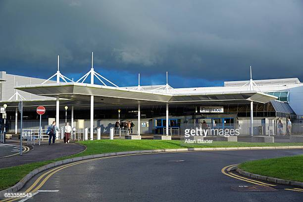 facade of the belfast international airport - belfast stock pictures, royalty-free photos & images