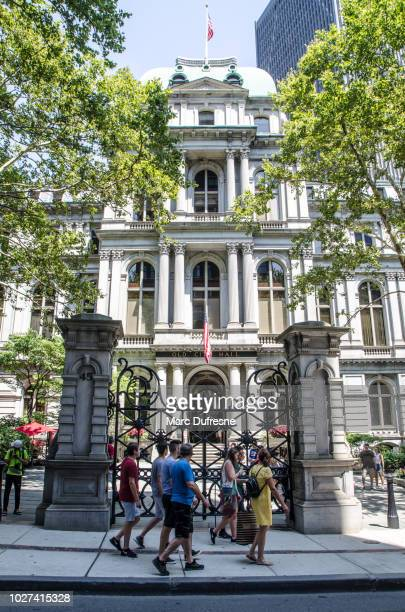 Facade of the Boston Old city hall during summer day with people passing by