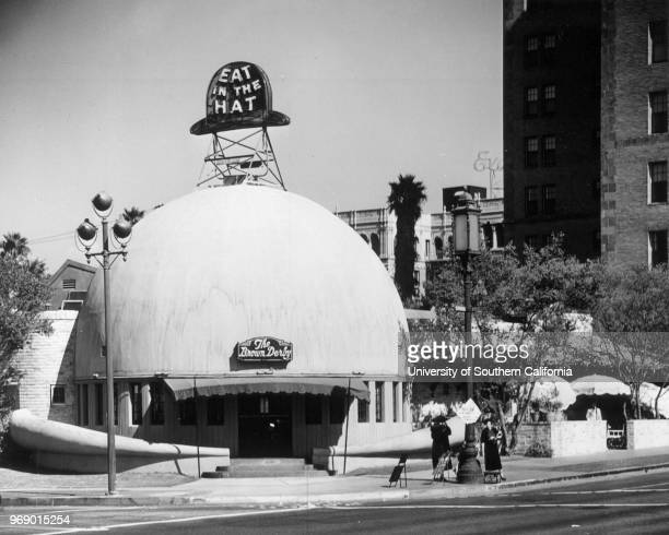 A facade of The Brown Derby in which the sign reads Los Angeles California early to mid twentieth century