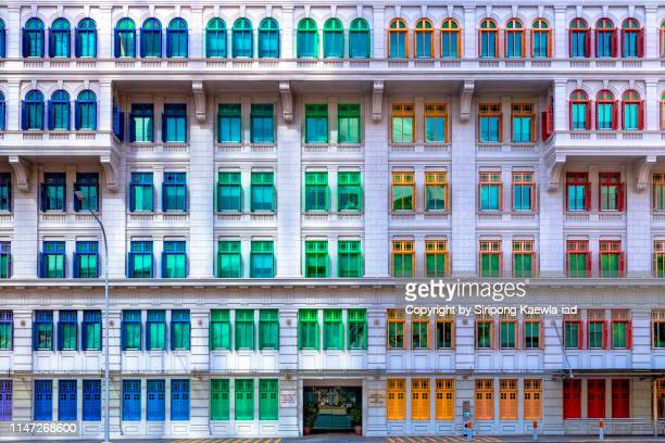 facade of the colorful windows at the old hill street police station in singapore. - シンガポール文化 ストックフォトと画像