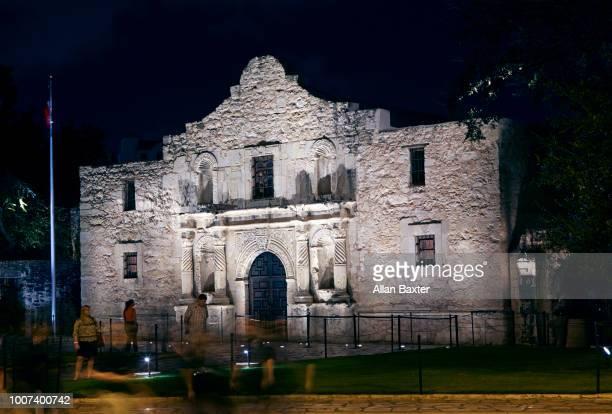 Facade of the historic 'Alamo' illuminated at night in San Antonio, Texas
