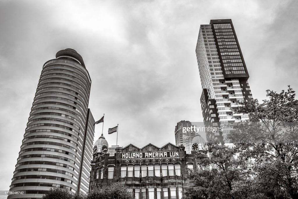 Facade of the Hotel New York with modern architecture in the background in Rotterdam : Stock Photo