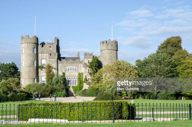 facade of the malahide castle in ireland during day of autumn - malahide stock photos and pictures