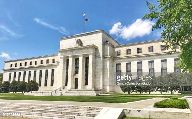 Facade of the Marriner S Eccles building of the United States Federal Reserve, on a bright and sunny day in Washington, DC, United States, July 24,...