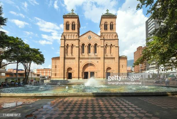 facade of the metropolitan cathedral of medellin in antioquia department, colombia - medellin colombia stock pictures, royalty-free photos & images