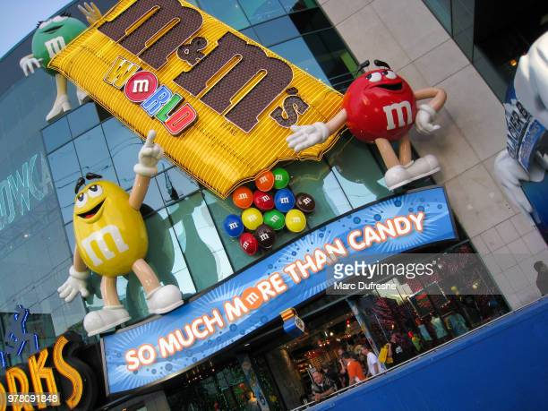 facade of the m&m candy store in las vegas during day - letter m stock pictures, royalty-free photos & images