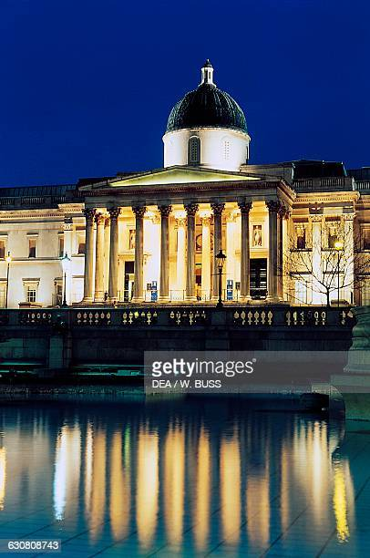 Facade of the National Gallery Trafalgar Square at night London England United Kingdom