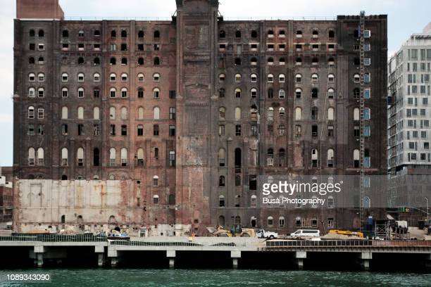 facade of the old domino sugar factory in 2017. brooklyn, new york city, usa - abandoned stock pictures, royalty-free photos & images
