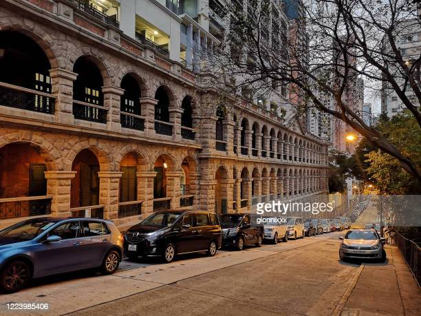 facade of the old mental hospital on high street, sai ying pun, hong kong island - psychiatric hospital stock pictures, royalty-free photos & images