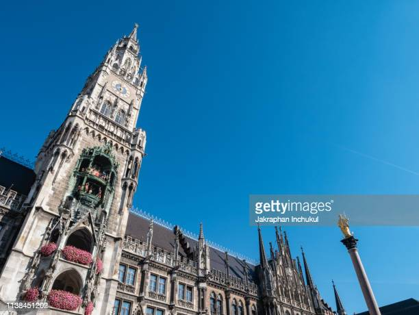 facade of the rathaus-glockenspiel of munich - marienplatz stock pictures, royalty-free photos & images