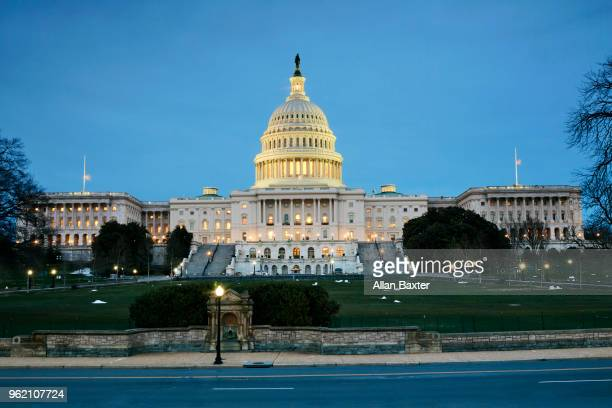 Facade of the US Capitol building in Washington DC at dusk