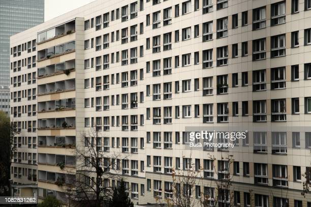 facade of typical prefabricated concrete slab building (plattenbau) in the center of east berlin, germany - east germany stock pictures, royalty-free photos & images