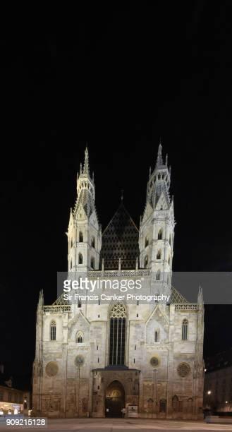 Facade of Vienna's Cathedral ('Stephansdom') in Gothic Style, illuminated at night on Stephansplatz, Vienna, Austria