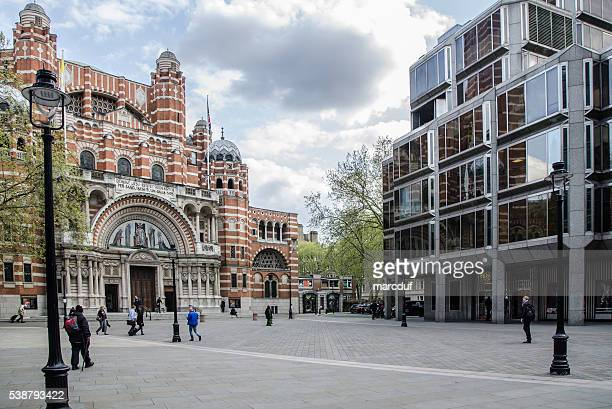Facade  of Westminster Cathedral beside a modern glass building