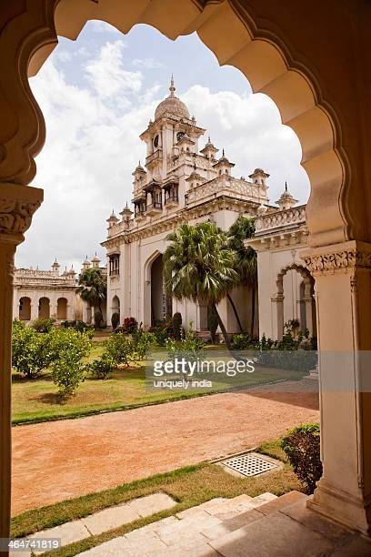 Facade view of a Palace through arch, Chowmahalla Palace, Hyderabad, Andhra Pradesh, India