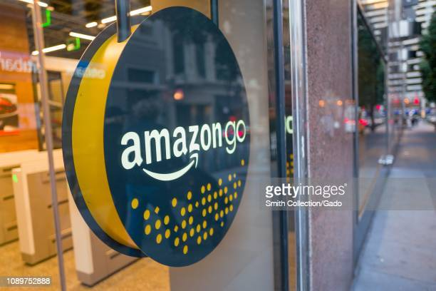 Facade with logo and sign at the Amazon Go concept store a physical retail store operated by Amazon in which shoppers are able to take items from...