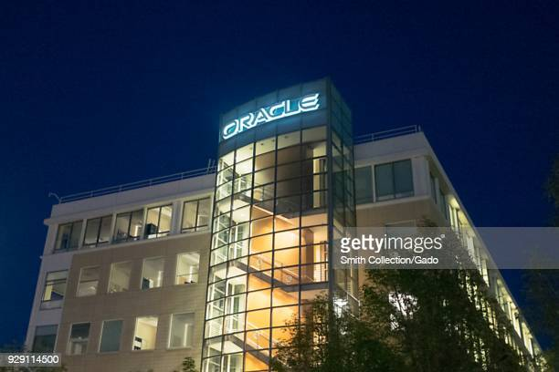 Facade with sign and logo at night at regional headquarters of technology company Oracle in the San Francisco Bay Area, Dublin, California, March 5,...