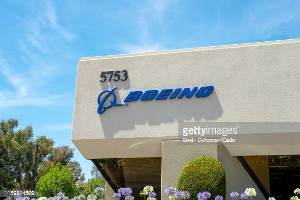 Facade with sign and logo at office of aerospace company Boeing in Pleasanton, California, July 2, 2019.