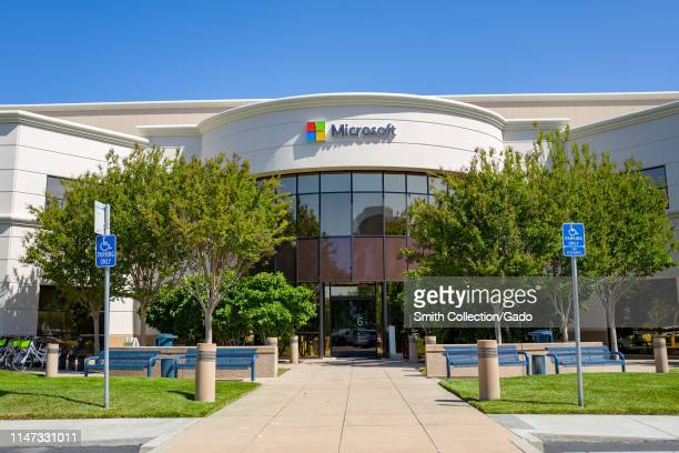 Facade with sign and logo at regional headquarters of computing company Microsoft in the Silicon Valley Mountain View California May 3 2019