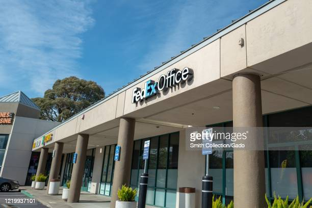 Facade with sign at branch of Federal Express office in San Ramon, California, April 15, 2020.