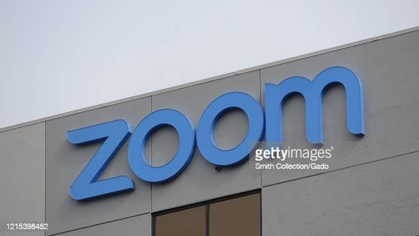 Facade with sign at headquarters of videoconferencing remote work and webinar technology company Zoom in the Silicon Valley San Jose California March...