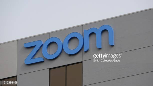 Facade with sign at headquarters of videoconferencing, remote work, and webinar technology company Zoom in the Silicon Valley, San Jose, California,...