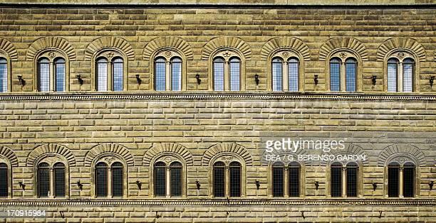 Facade with twomullioned windows Palazzo Strozzi Alinari Via de' Tornabuoni Florence Tuscany Italy