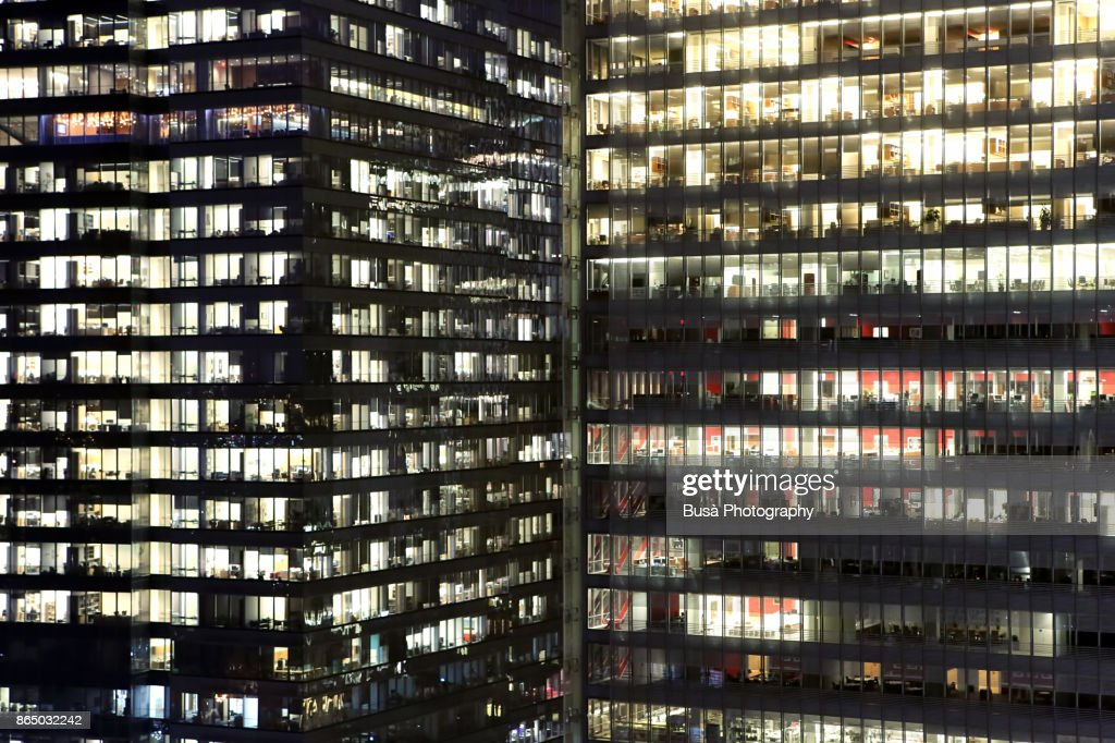 Facades of office buildings in Midtown Manhattan at night, New York City : Stock Photo