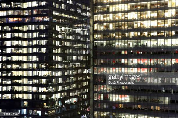 Facades of office buildings in Midtown Manhattan at night, New York City