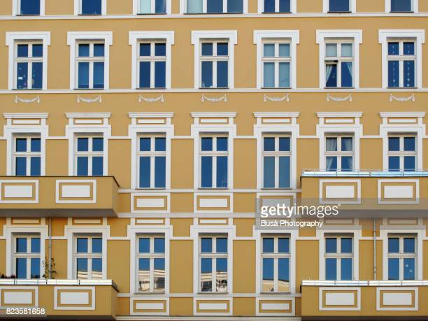 facades of ornate residential buildings in the district of prenzaluer berg, berlin, germany - gebäudefront stock-fotos und bilder