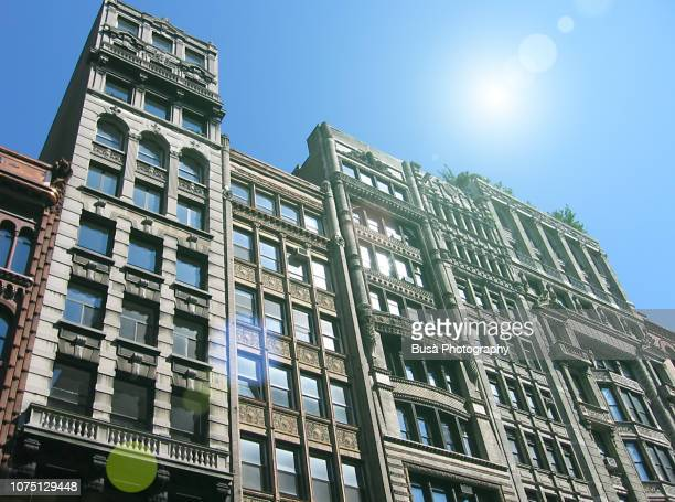 facades of pre-war highrise residential buildings in soho, manhattan, new york city, at night - soho new york stock pictures, royalty-free photos & images
