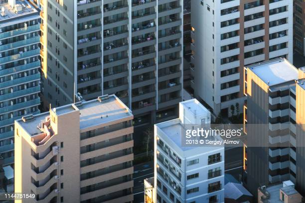 facades of residential buildings in tokyo - wall building feature stock pictures, royalty-free photos & images