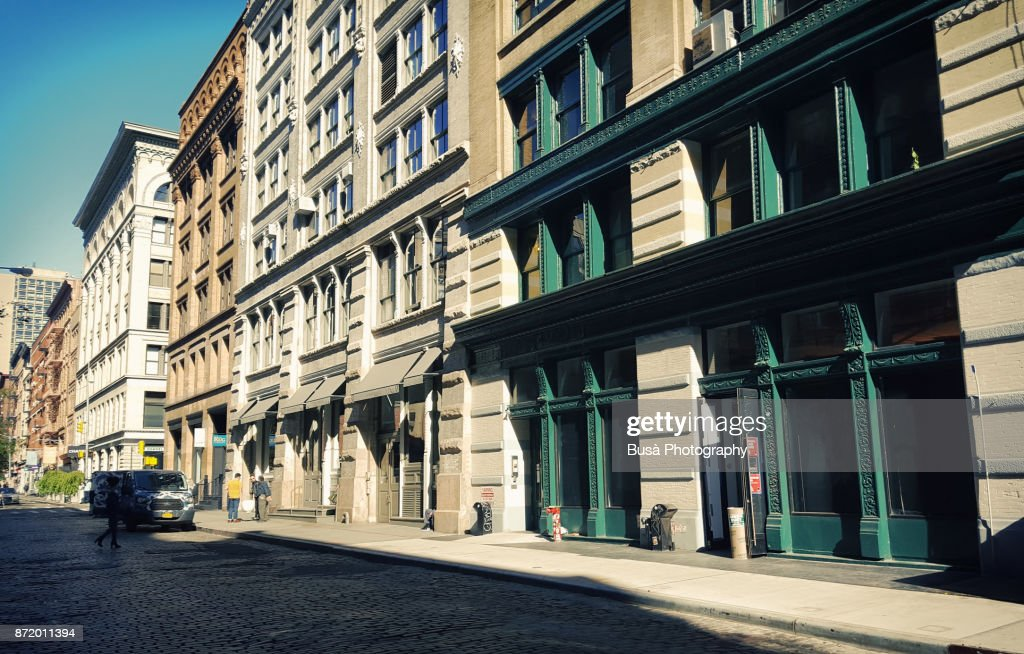Facades of typical cast iron buildings with fire escapes along Greene Street in the Soho Cast Iron Historic District, Manhattan, New York City : ストックフォト