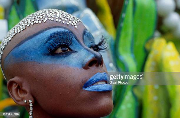 Face adornments and body painting Samba Schools Parade Rio de Janeiro carnival in Brazil wig made of small pieces of mirror simulating diamonds