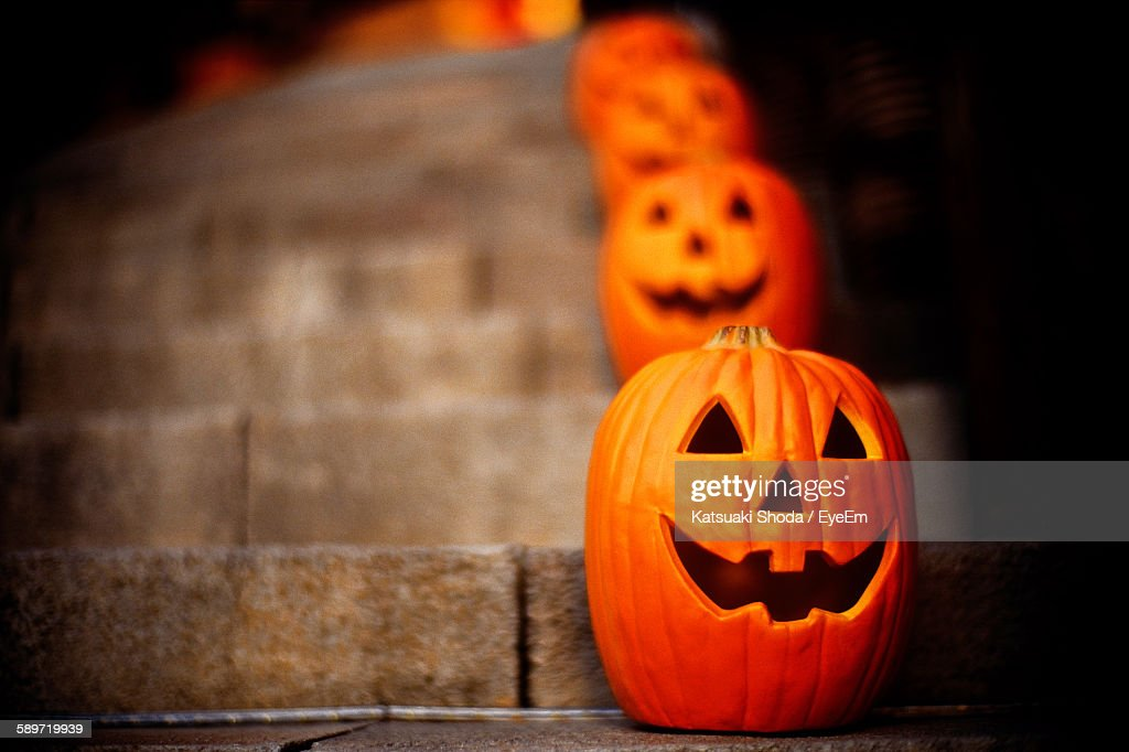 Face Carved Pumpkins In Row On Steps During Halloween : Stock Photo