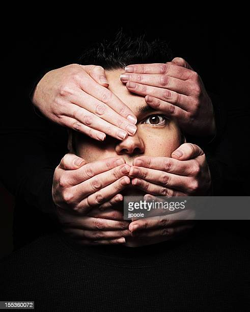 face covered with many hands, opression, hidden, mask - see no evil hear no evil speak no evil stock pictures, royalty-free photos & images