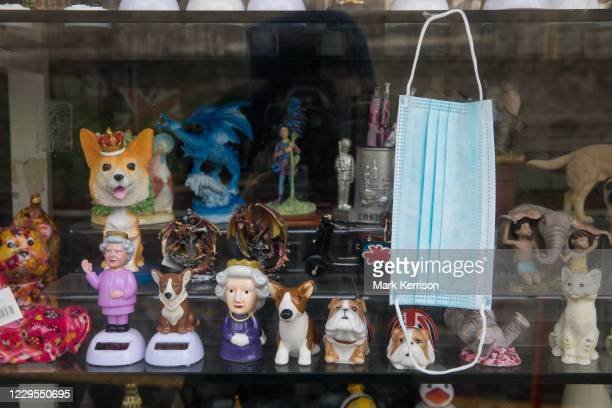 Face covering and souvenirs are pictured in the window of a closed gift shop during the second coronavirus lockdown on 9th November 2020 in Windsor,...