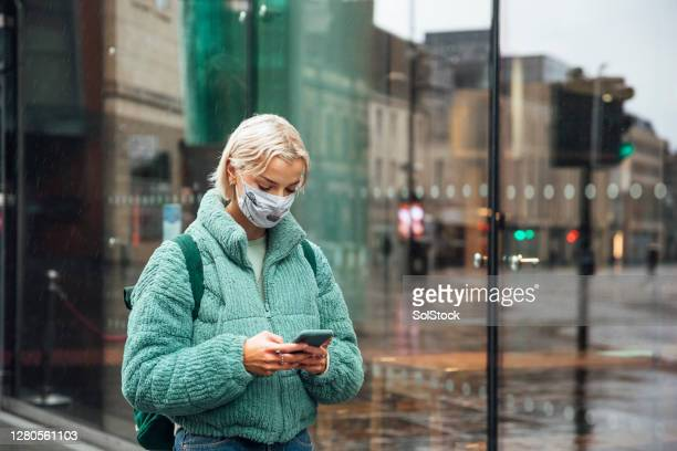 face covering in public - high street stock pictures, royalty-free photos & images