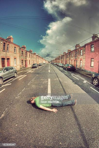 face down in middle of street - scott macbride stock pictures, royalty-free photos & images