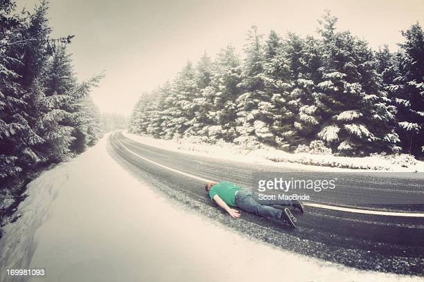 face down on a snowy road