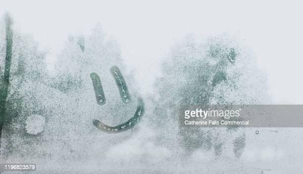 face drawn in condensation - condensation stock pictures, royalty-free photos & images