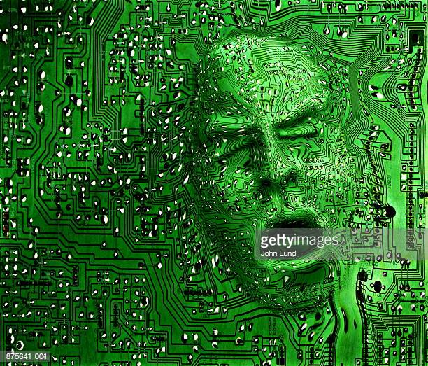 face emerging from circuit board (digital composite) - l'uomo e la macchina foto e immagini stock